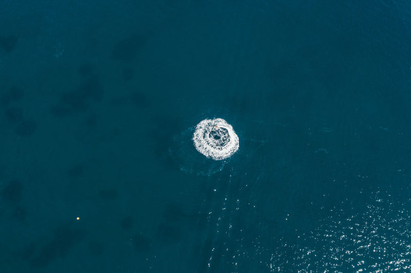 High angle view of bubbles over sea