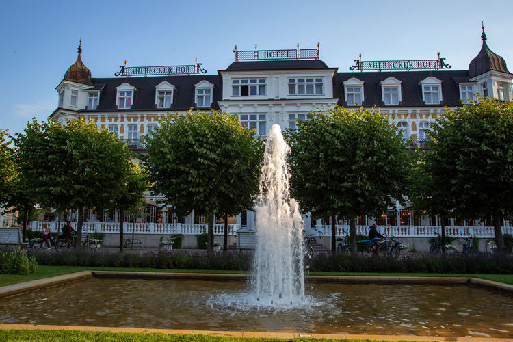 Architecture Building Building Exterior Built Structure City Day Flowing Water Fountain Long Exposure Motion Nature No People Outdoors Plant Sky Spraying Tourism Travel Destinations Tree Water Waterfront
