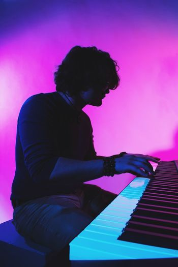 Piano Moments Music Musical Instrument One Person Lifestyles Musician Purple Jazz Music Performance Silhouette Indoors  Piano One Man Only Playing Pianist Human Hand Popular Music Concert People Young Adult Colors