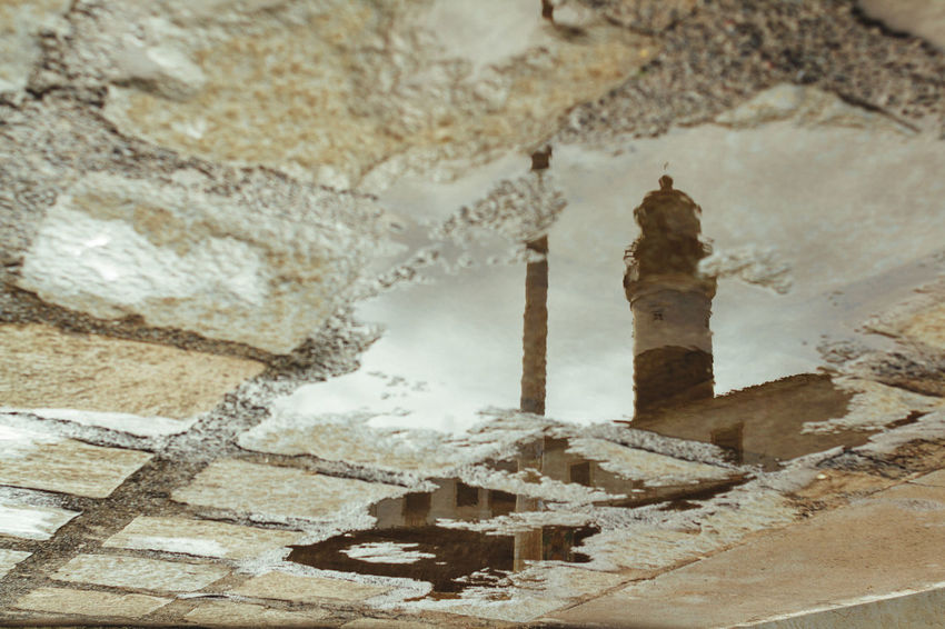 Farol Da Barra Lighthouse Architecture Built Structure No People Rainy Day Reflections Reflections In The Water Travel Destinations Upside Down Upside Down Reflection