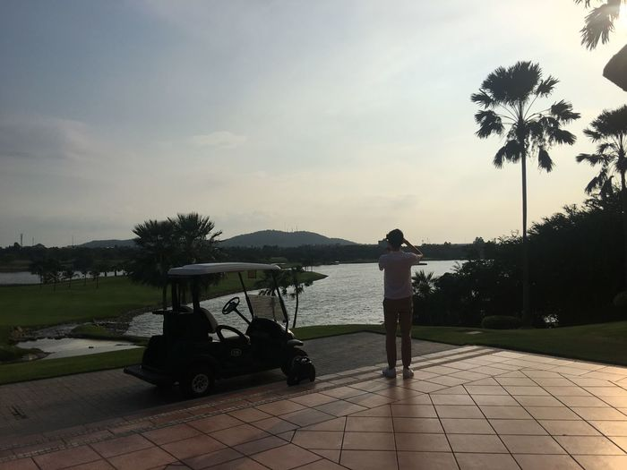 Sky Tree Real People Plant Nature Transportation Leisure Activity Women Mode Of Transportation Full Length Lifestyles Cloud - Sky Water Palm Tree Men People Adult Golf Silhouette