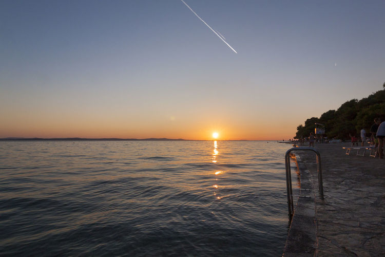 The sun setting in Zadar, Croatia. Sea Water Sky Beach Sunset Scenics Horizon Over Water Clear Sky Nature Outdoors Beauty In Nature Nautical Vessel No People Night Astronomy Zadar Croatia Cloud - Sky Tranquil Scene Travel Destinations Tourism Tranquility Sun Nature Vacations