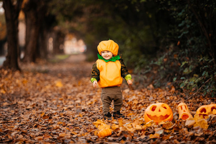 Boy standing on field during autumn