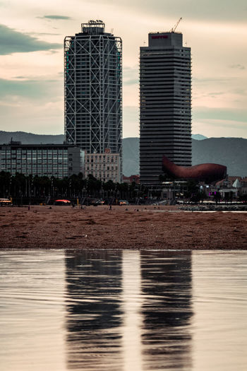 Built Structure Architecture Building Exterior Sky Water Waterfront Building City Reflection Cloud - Sky Nature Office Building Exterior Modern Sunset No People River Outdoors Skyscraper Tall - High Barcelona Barceloneta Beach Plage Playa Tower Torrential Rain