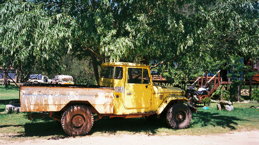 35mm 35mm Film Africa Day Delivery Landcruiser  Motorcycle Motorcycles No People Old Outdoors Parked Pickup Pickup Truck Transportation Tree Truck Vintage Vintage Cars Yellow