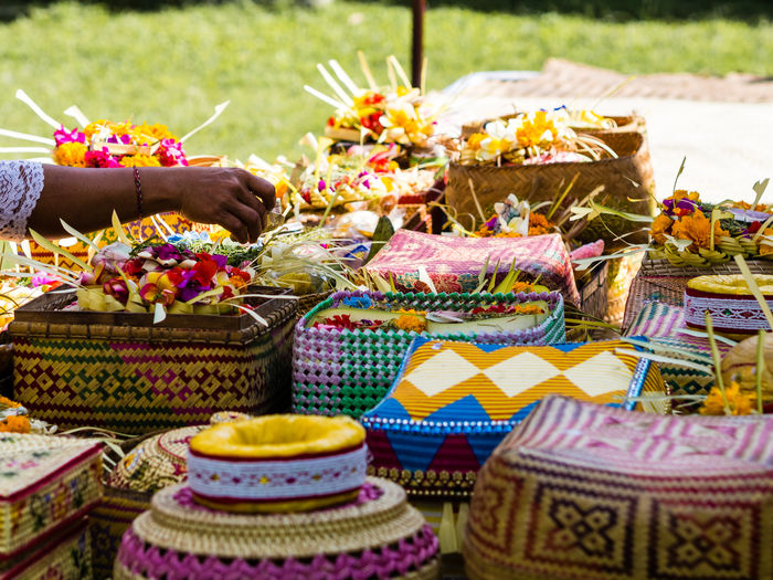 Bali Basket Baskets Burning Ceremony Close-up Colourful Day Flower Food Freshness Garland Hand INDONESIA Multi Colored No People Offering Outdoors Place Of Worship Religion Variation Woman Woven Baskets