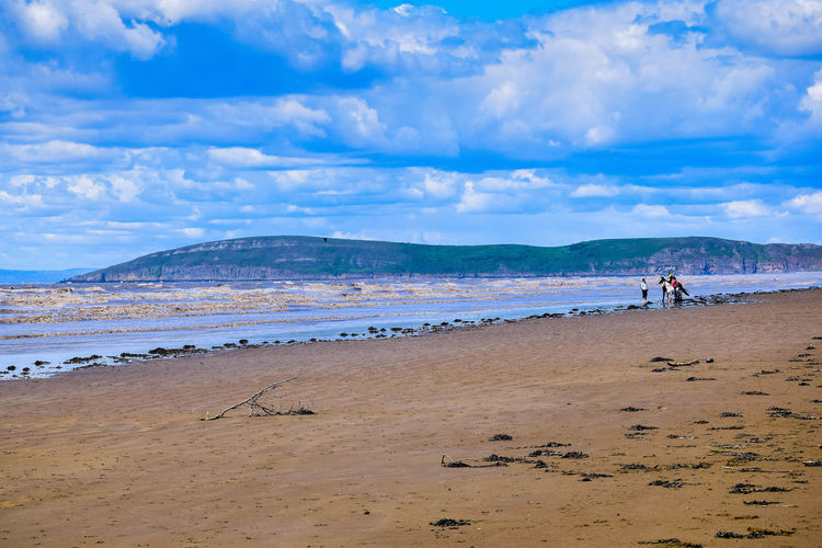 Sky Land Beach Scenics - Nature Sea Nature Beauty In Nature Beach Photography Horizon Over Water Day At The Beach Sand Sea And Sand Leading Lines Blue Sky Space For Text Space For Copy Brean Down Water Cloud - Sky Real People Tranquil Scene Mountain Tranquility Non-urban Scene Idyllic Lifestyles Men