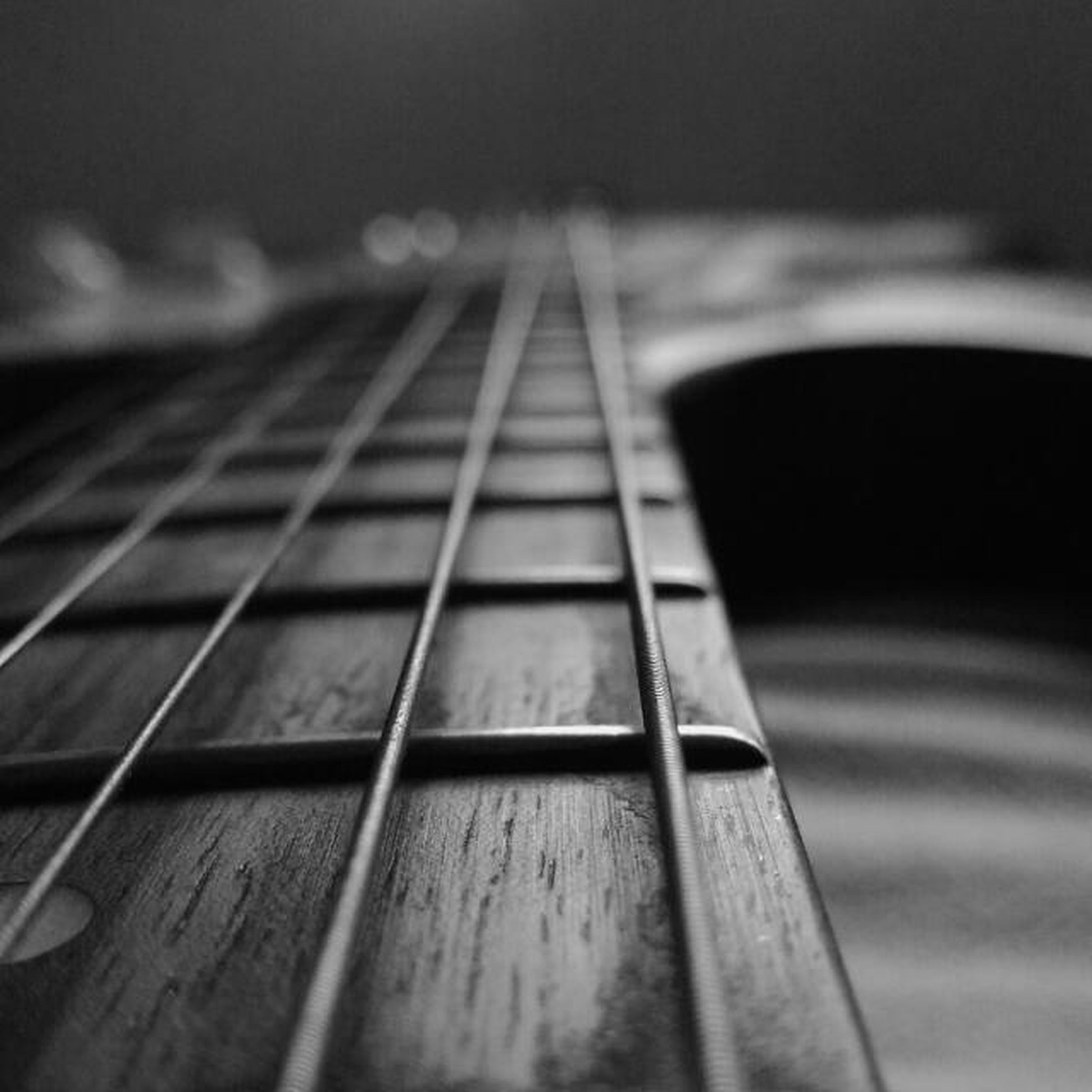 selective focus, indoors, wood - material, the way forward, surface level, close-up, focus on foreground, diminishing perspective, empty, metal, absence, no people, railing, shadow, steps, musical instrument, music, wood, steps and staircases, wooden