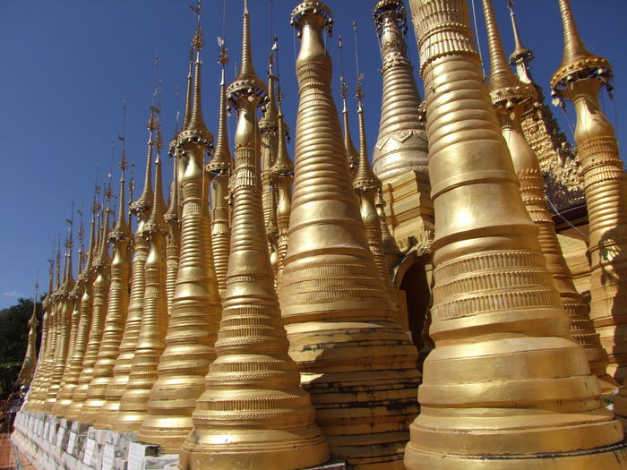 Modern Forest of Stupas Blue Sky Buddhist Architecture Buddhist Stupas Composition Full Frame Gold Colour Inle Lake Kakku Myanmar No People Outdoor Photography Pilgrimage Place Of Prayer Place Of Worship Religion Religious Sites Rows Of Things Shan State Side By Side Stupas Sunlight And Shadows Tourism Tourist Attraction  Tourist Destination