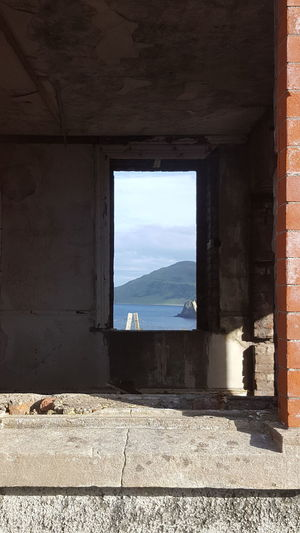 You can see forever Window Shadow Sunlight Frame Summer No People Old Ruin Indoors  Sky Architecture Ireland Coast Business Finance And Industry Built Structure Day Cityscape Close-up Abandoned Buildings Abandoned Places Derelict Vision Great Outdoors Hikingadventures