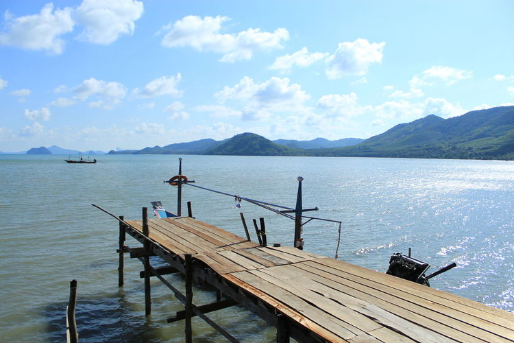 Fisherman's Village Ban Thong Tom Yai Beauty In Nature Cloud - Sky Day Idyllic Mountain Mountain Range Nature Nautical Vessel No People Non-urban Scene Outdoors Pier Scenics - Nature Sea Sky Tranquil Scene Tranquility Water Wood - Material