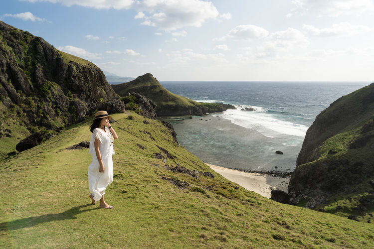 Summer at Batanes Philippines Summer Road Tripping Woman Batanes Beach Beauty In Nature Day Hill Horizon Horizon Over Water Land Leisure Activity Mountain Nature One Person Outdoors Portrait Real People Rock Scenics - Nature Sea Sky Summer Vacation Water