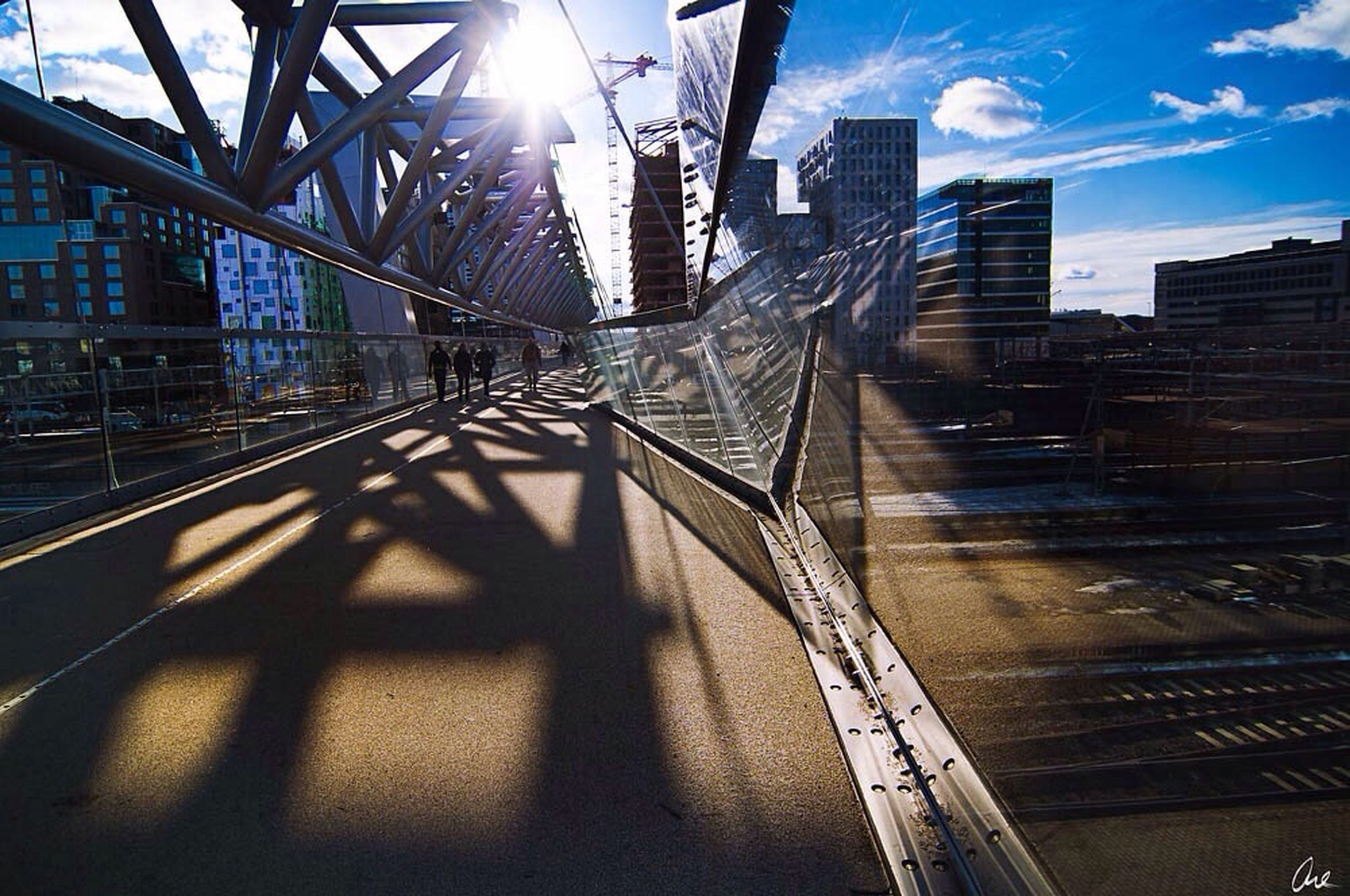 architecture, built structure, building exterior, city, sunlight, sunbeam, sun, lens flare, sunny, sky, transportation, the way forward, building, modern, shadow, office building, skyscraper, diminishing perspective, day, city life