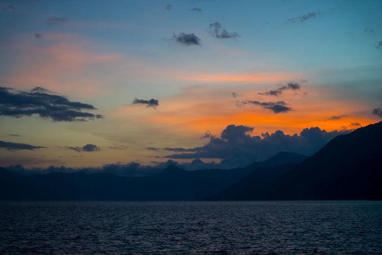 Atitlan Lake Guatemala PanajachelGuatemala Atitlan Guate Idyllic Lake Lake View Landscape Nature No People Outdoors Panajachel  Scenics Silhouette Sky Sunset Tranquil Scene Tranquility Water Waterfront Perspectives On Nature