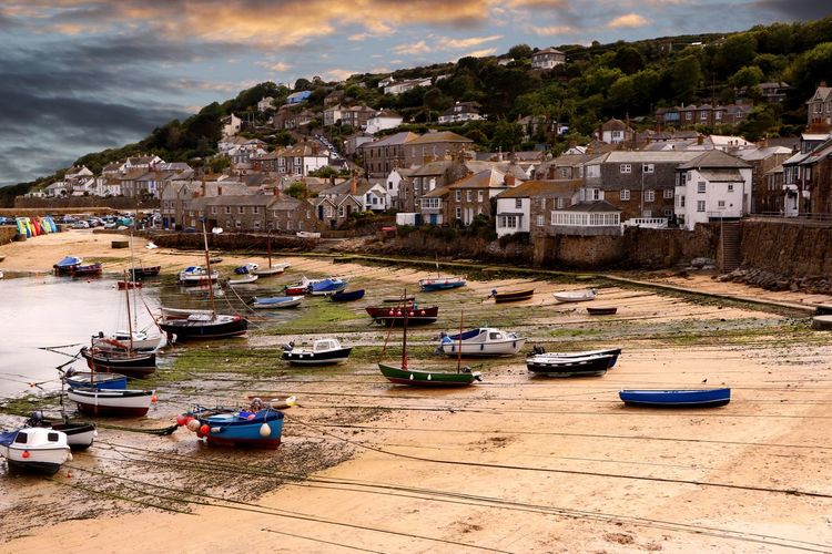 Low tide on a late afternoon at Mousehole harbour in Cornwall England Cloudy Day Harbour View Moored Boats Mousehole Harbour Transportation Travel Travel Photography Beach Beauty In Nature Boats Cornwall Fishing Boat Harbor View Low Tide Mode Of Transport Nautical No People Outdoors Seaside Seaside Town Small Boats Tourist Destination Travel Destination Vessels In Port Village
