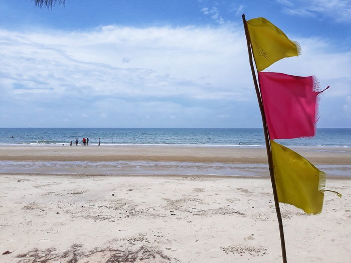 Sea Water Beach Sky Flag Land Cloud - Sky Sea Water Beach Sky Flag Land Cloud - Sky Sand Nature Horizon Day Beauty In Nature Yellow Outdoors
