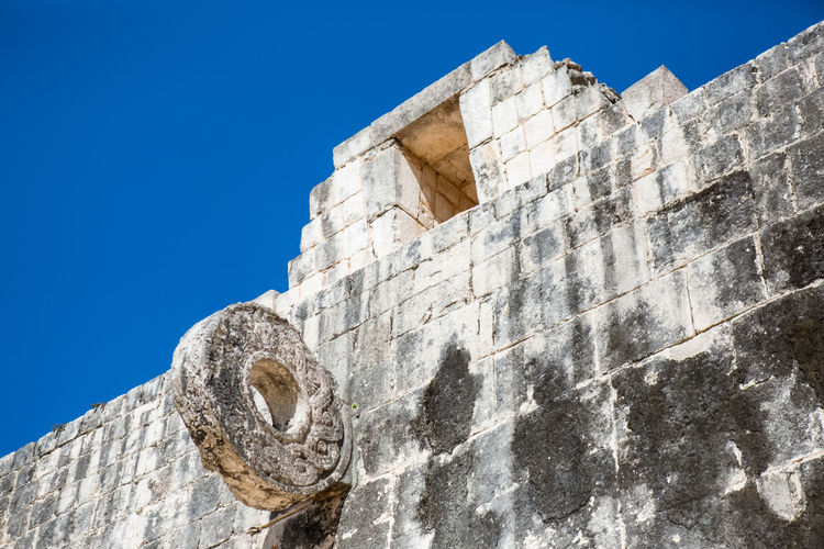 Low Angle View Of Old Ruin Against Clear Blue Sky
