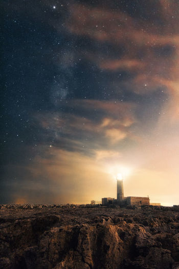 Architecture Astronomy Beauty In Nature Building Building Exterior Built Structure Cloud - Sky Environment Guidance Landscape Lighthouse Nature Night No People Outdoors Scenics - Nature Sky Space Star - Space Tower