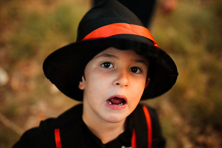 Close-up portrait of boy wearing hat during halloween at forest