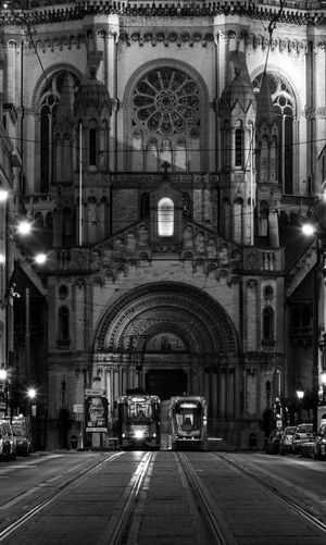 Tram Spirit Crop  Bruxelles Church Belgium Brussels Blackandwhite Arch Architecture Built Structure Illuminated Building Exterior The Way Forward Building Mode Of Transportation Transportation Direction Night City Land Vehicle Outdoors Travel Street Travel Destinations