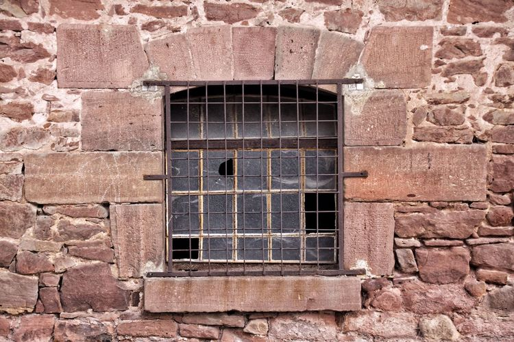 Brick Wall With Closed, Broken Window