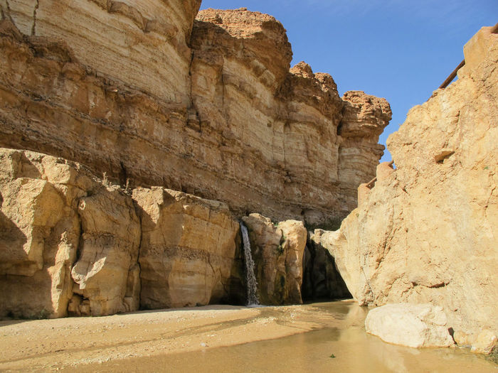 Tunisia travel holidays Rock Rock - Object Rock Formation Solid Tranquility Nature Geology Scenics - Nature Day Tranquil Scene No People Sky Beauty In Nature Water Physical Geography Land Non-urban Scene Cliff Travel Destinations Outdoors Eroded Ancient Civilization Sandstone