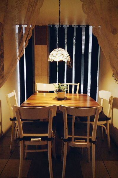 Chair Indoors  No People Built Structure Table Warm Light Dinning Table Cozy Place Relax Curtain Standing Light Interior Design Decoration Down Light Indoor Plant
