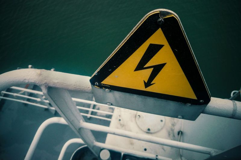 High angle view of high voltage sign on ship