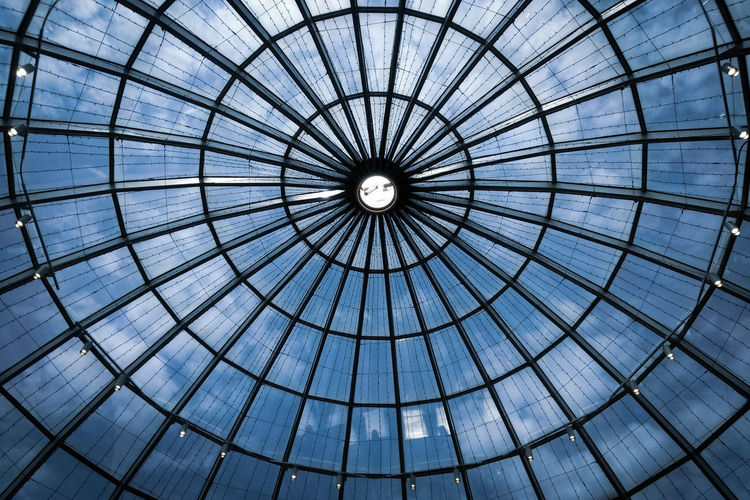 Blue sky with clouds behind a glass dome Circles In Circles Circle Concentric Pattern Clouds And Sky Sky And Clouds Backgrounds Full Frame Pattern Sky Architecture Built Structure Architectural Design Ceiling Cupola Architecture And Art Skylight Dome Geometric Shape Architectural Detail Architectural Feature LINE