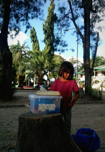 Saw this girl selling food for her allowance in school at a park. Child Portrait ChildChildhood Working Girl Girl Power Girl Person Park Park - Man Made Space Outdoors Day Innocence The Week On EyeEem Mobile Editing Mobile Photography Life People at Panabo City Philippines