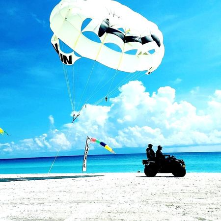 Beach Sea Cloud - Sky Sky Sand Transportation Day Blue Outdoors Horizon Over Water Water Nature People Beach Patrol Turqouise Water Tropical Climate Travel Destinations Scenics