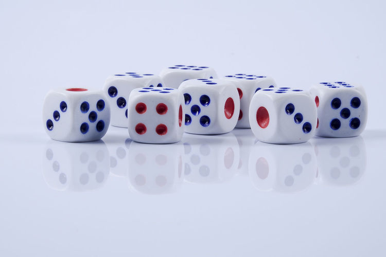 DICES ISOLATED ON WHITE Arts Culture And Entertainment Close-up Copy Space Dice Gambling Game Of Chance Group Of Objects Indoors  Leisure Activity Leisure Games Luck No People Number Opportunity Relaxation RISK Still Life Studio Shot Table White Background White Color