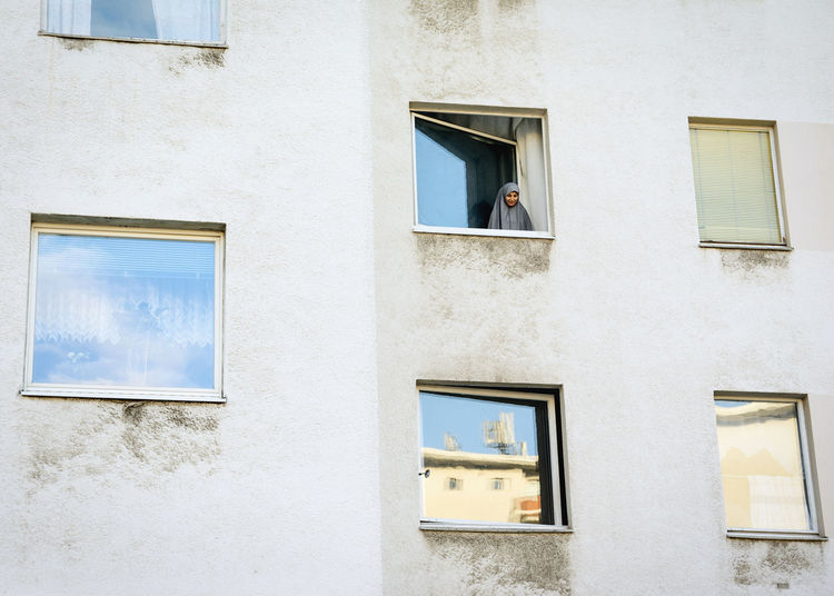 Wait in Berlin Arab Woman Flat Building Open Window Reflection Concrete Urban Real Life Street Photography Documentary Moody Waiting Linas Was Here