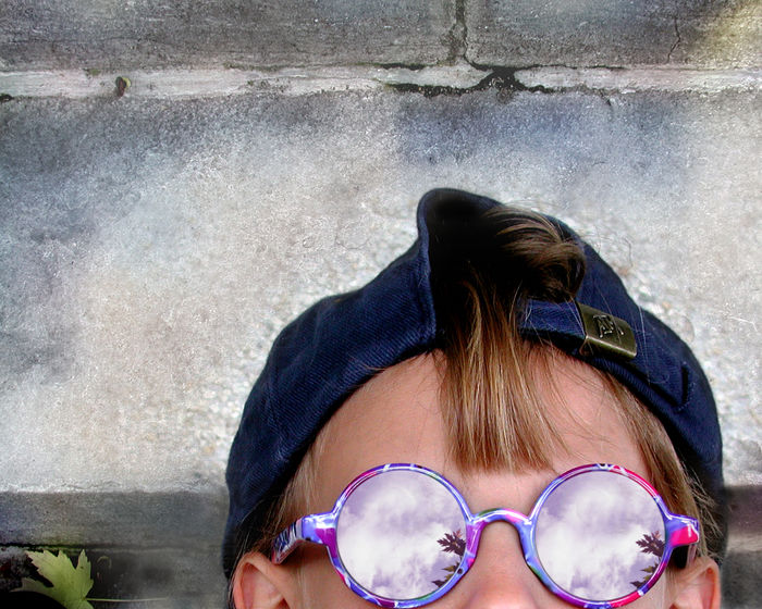 Adult Architecture Day Eyewear Fashion Females Glasses Hair Hairstyle Headshot Human Face Human Hair Leisure Activity Lifestyles One Person Outdoors Portrait Real People Sunglasses Wall Wall - Building Feature Women