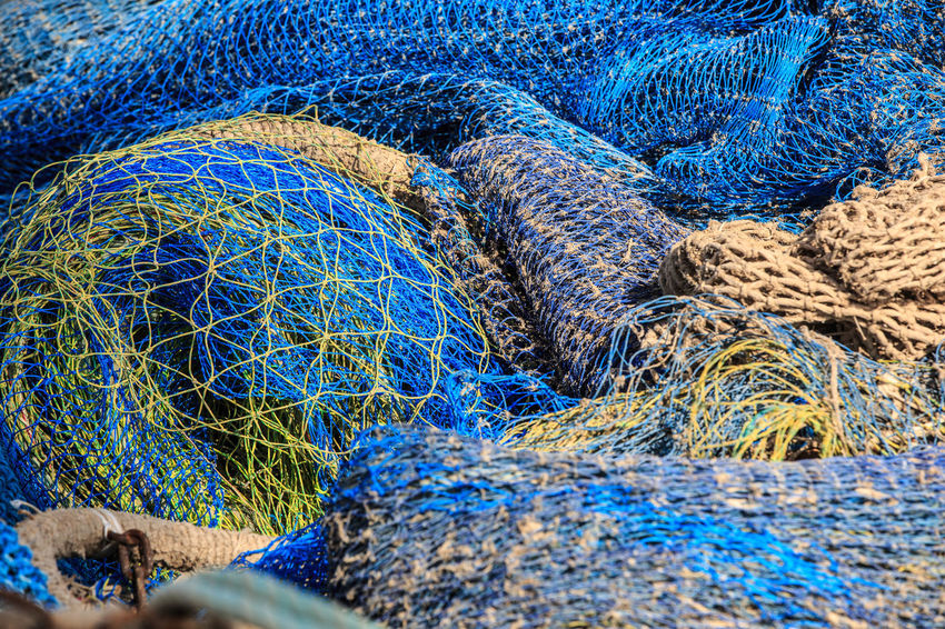 Backgrounds Blue Commercial Fishing Net Equipment Fishing Fishing Industry Fishing Net Fishing Rod Full Frame High Angle View No People Outdoors Pattern Rope Still Life Turquoise Colored