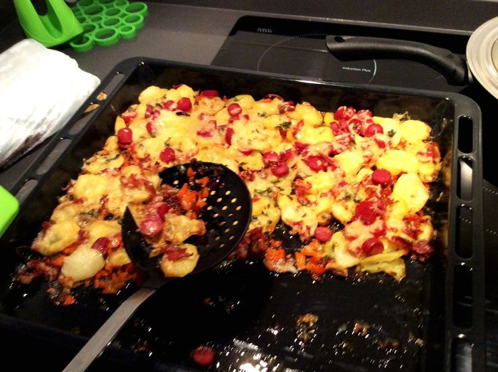 What's For Dinner? Taking Photos Potatoes With Vegetables And Sausages Baked.