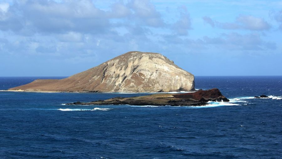 Islands Off a Beach in Hawaii Pacific Beauty In Nature Cloud - Sky Day Horizon Horizon Over Water Idyllic Island Land Mountain Nature No People Outdoors Pacific Coast Pacific Ocean Rock Scenics - Nature Sea Sky Solid Tranquil Scene Tranquility Water Waterfront