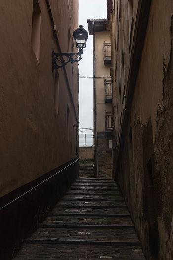 Steps Amidst Buildings Against Sky