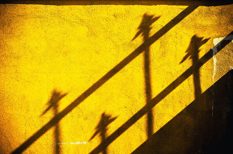 Four spears Four Wall Abstract Architecture Auto Post Production Filter City Day Focus On Shadow High Angle View Leisure Activity Lifestyles Men Nature Outdoors People Real People Shadow Spears Standing Street Sunlight Unrecognizable Person Wall - Building Feature Yellow
