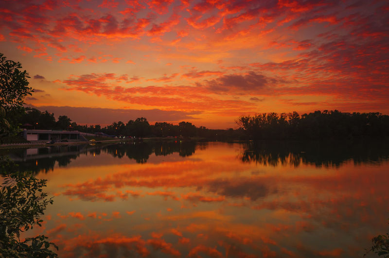 Beautiful Sunset Scenery With Reflection on lakes. Sunset And Clouds  Beauty In Nature Cloud - Sky Idyllic Lake Nature No People Orange Color Outdoors Reflection Reflection Lake Scenics Silhouette Sky Standing Water Sunset Sunset Background Tranquil Scene Tranquility Tree Water