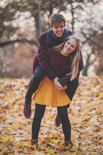 Role Reversal EyeEm Selects Winter Warm Clothing Autumn Happiness Emotion Young Adult Two People Smiling Cold Temperature Young Women Clothing Women Togetherness Lifestyles Full Length Positive Emotion Adult Nature Scarf Portrait Autumn Happiness Tree Adult Winter Plant Part Nature