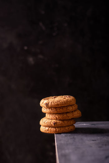 A stack of chocolate cookies on the edge of the table