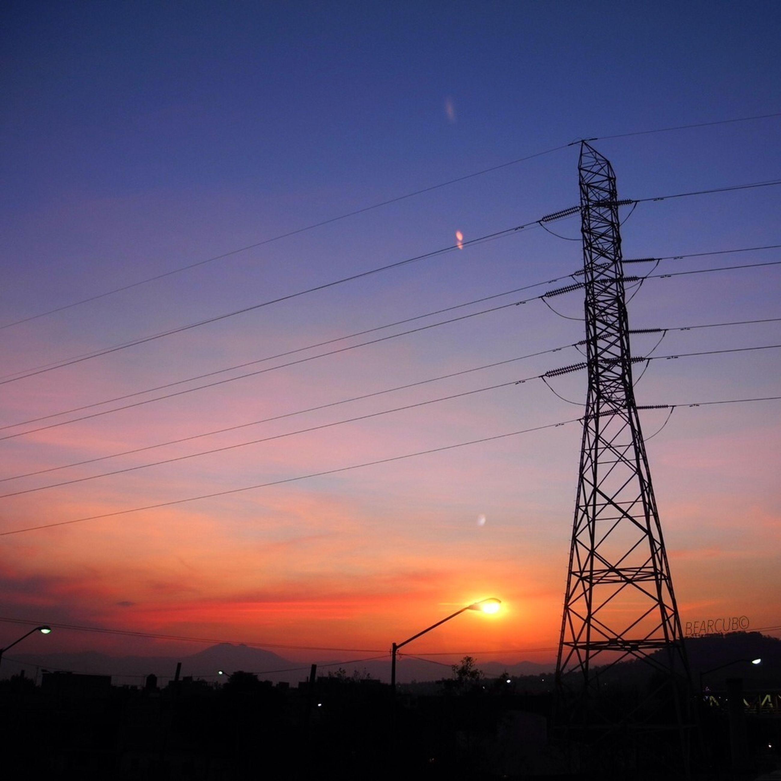 sunset, silhouette, electricity pylon, power line, power supply, electricity, orange color, sky, connection, fuel and power generation, technology, low angle view, cable, scenics, beauty in nature, sun, nature, power cable, built structure, cloud - sky
