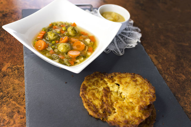 Potatoe fritters with vegetable soup and apple mash Brussels Sprouts Copy Space Leek Meal Vegetarian Vitamins Apple Mash Apple Puree Applesauce  Carrots Cauliflower Food German Food Home Feeling No People Peas Potato Pancake Potatoe Fritters Soup Strong Traditional Fare Traditionally Vegan Vegetable Soup Vegetables Food Stories