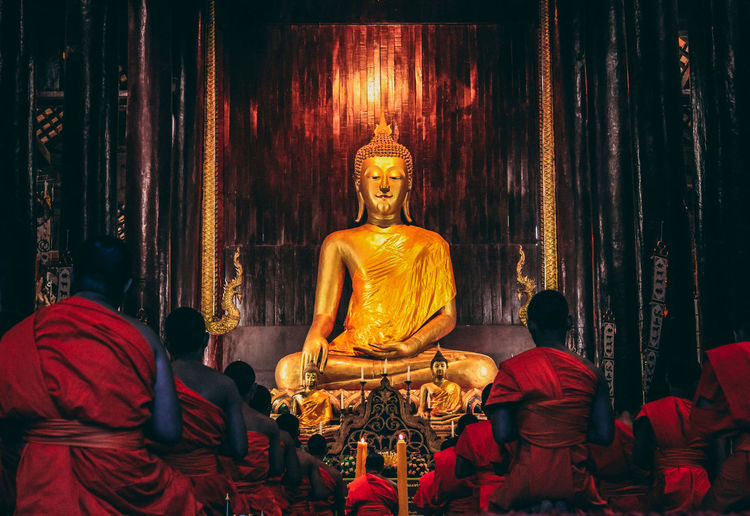 Temple in Chiang Main, Thailand. They just started to pray. Religion Spirituality Belief Human Representation Male Likeness Representation Sculpture Art And Craft Statue Place Of Worship Gold Colored Building Idol Architecture Built Structure Indoors  Creativity