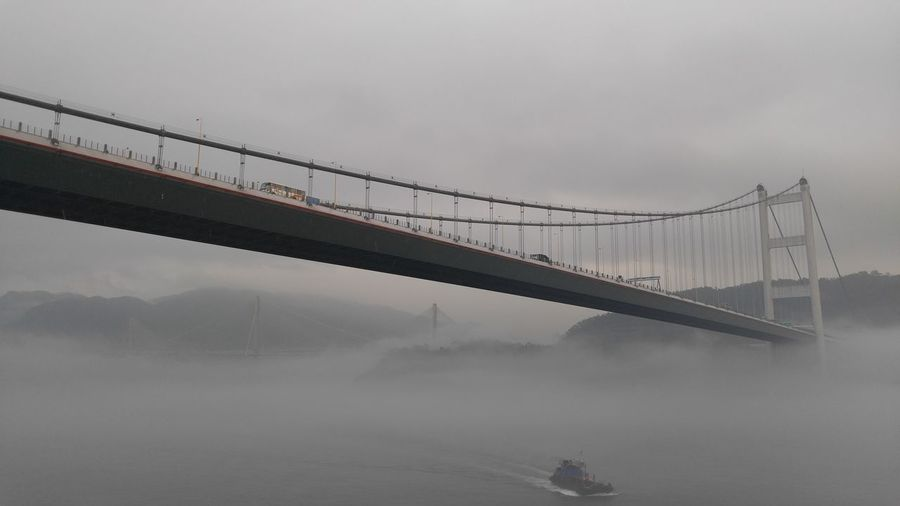 Low angle view of bridge on a foggy day