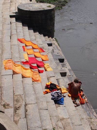 High angle view of people sitting on shore