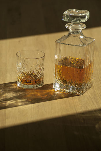 High Angle View Of Whiskey On Hardwood Floor During Sunny Day