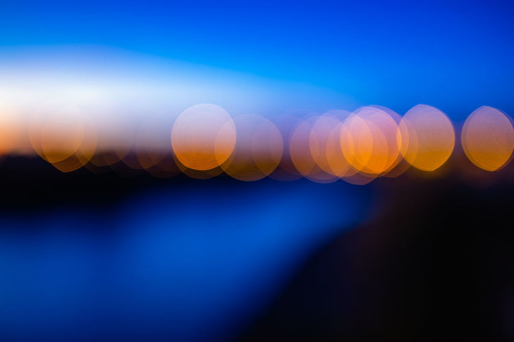 Abstract sunset Abstract Abstract Backgrounds Backgrounds Blue Blurred Motion Bright Defocused Futuristic Glowing Illuminated Lens Flare Light Light - Natural Phenomenon Lighting Equipment Motion Multi Colored Nature Night No People Outdoors Shape Sky Softness Vibrant Color Capture Tomorrow
