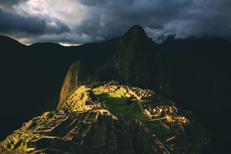 The ever so mysterious Machu Picchu with beams of sun light shot around Sunset time. Machu Picchu Peru Inca Inca Ruins Ancient Civilization Outdoors Mountain Peak Architecture Cloud - Sky History Tourism Archaeology Ruined Old Ruin Travel Destinations Ancient Scenics - Nature No People Beauty In Nature Shadows & Lights Spotlight Sunset Afternoon Machu Picchu - Peru Travel Photography